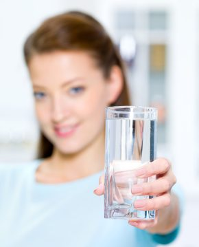 Woman shows a Water Glass