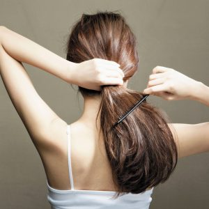 woman-brushing-unruly-hair-700