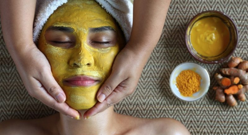 Woman with Tumeric Face Mask