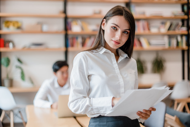 woman in the modern company office with work papers