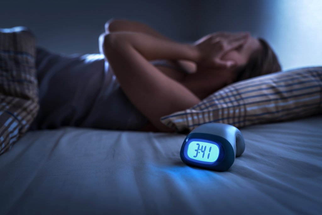 Sleepless woman suffering from insomnia, sleep apnea or stress