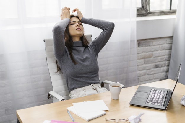 Businesswoman looking frustrated while working from home