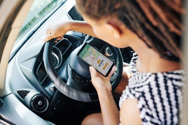 Woman using car sharing application
