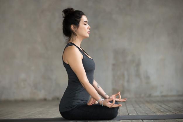 woman doing sukhasana exercise,