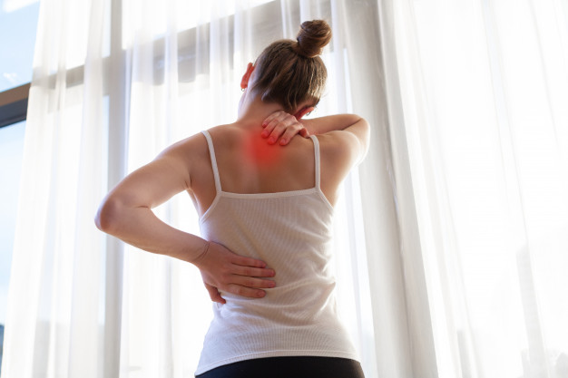 woman suffering from neck pain and backache