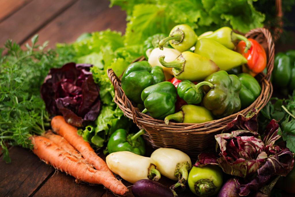 Vegetables in a basket on a dark background