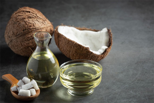 Jug of coconut oil whit coconut