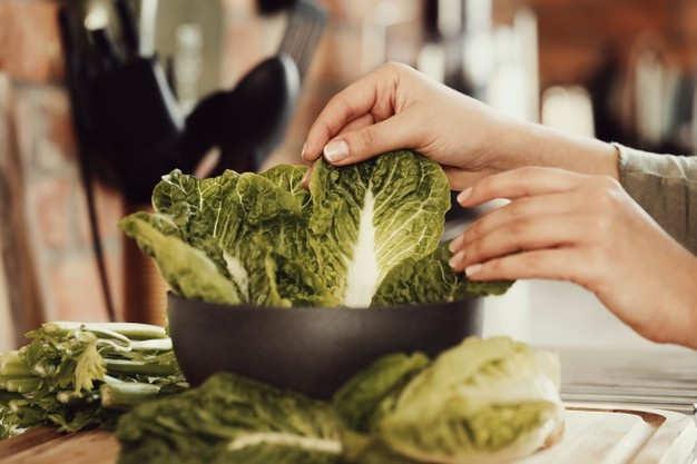Woman cooking with lettuce